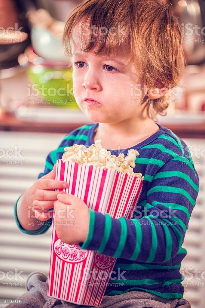 Cute Little Boy Eating Homemade Popcorn stock photo