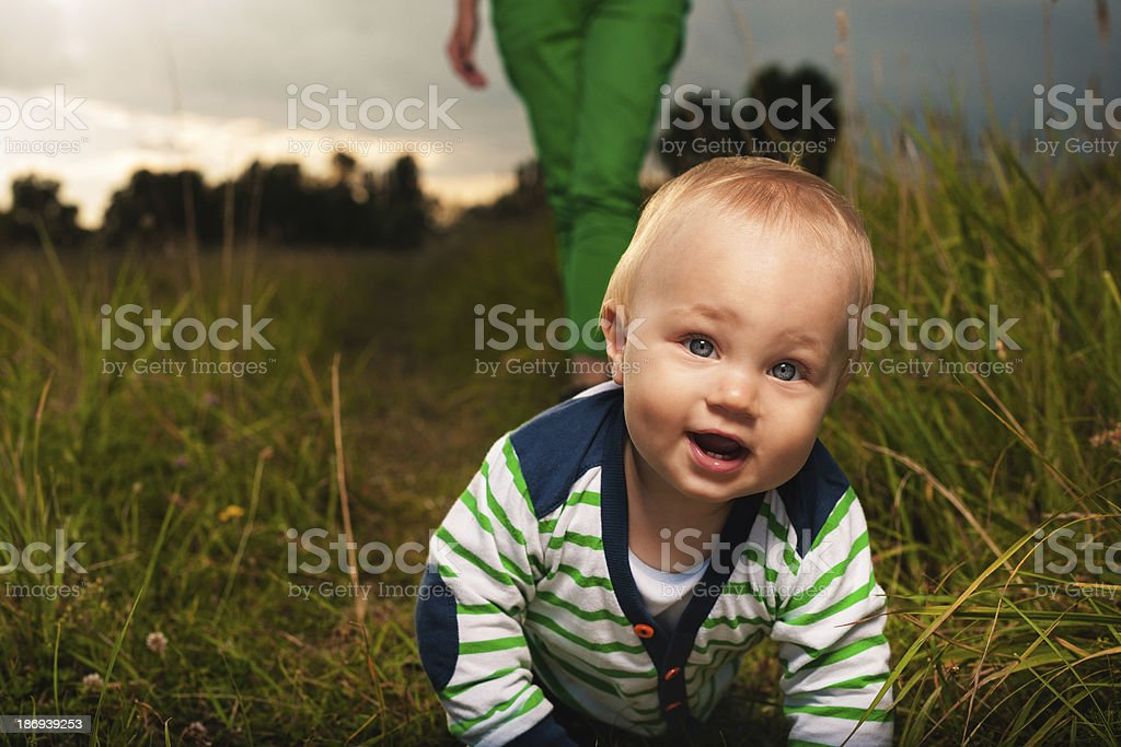 Cute little boy exploring the world on all fourth royalty-free stock photo