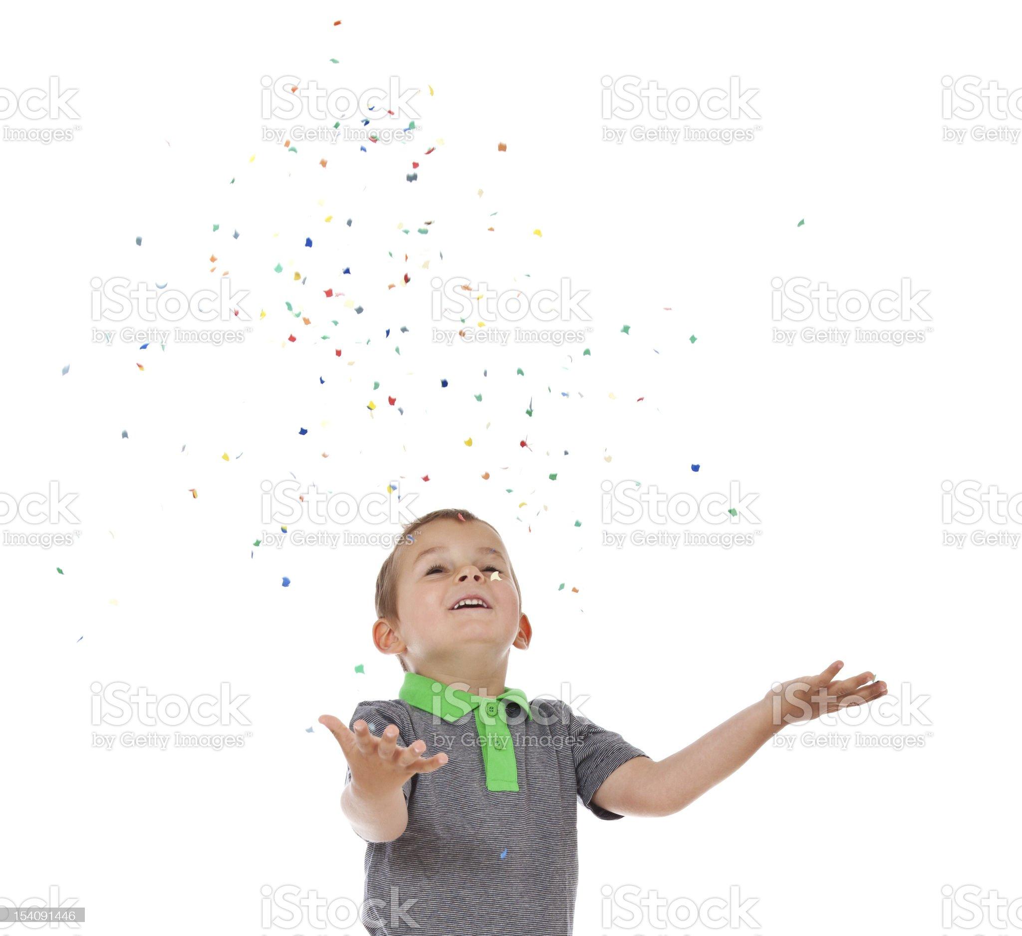 Cute little boy having fun with confetti royalty-free stock photo