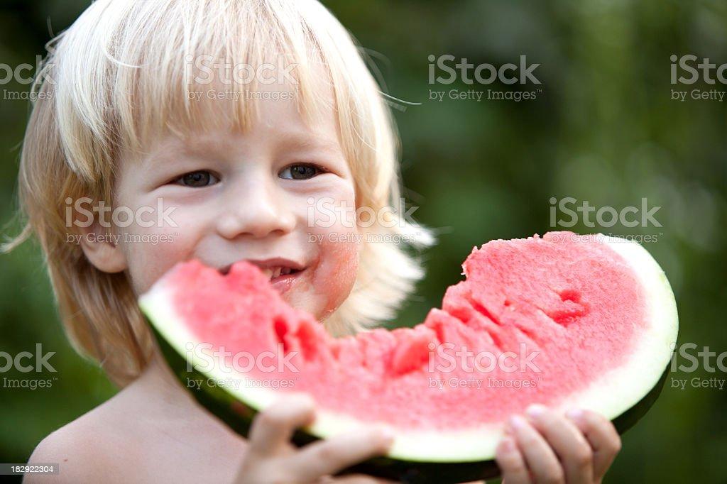 Cute little boy holding a waterlemon royalty-free stock photo