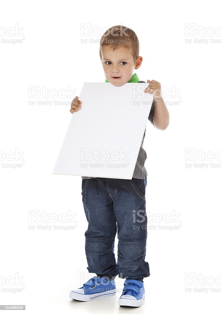 Cute little boy holding blank white sign royalty-free stock photo