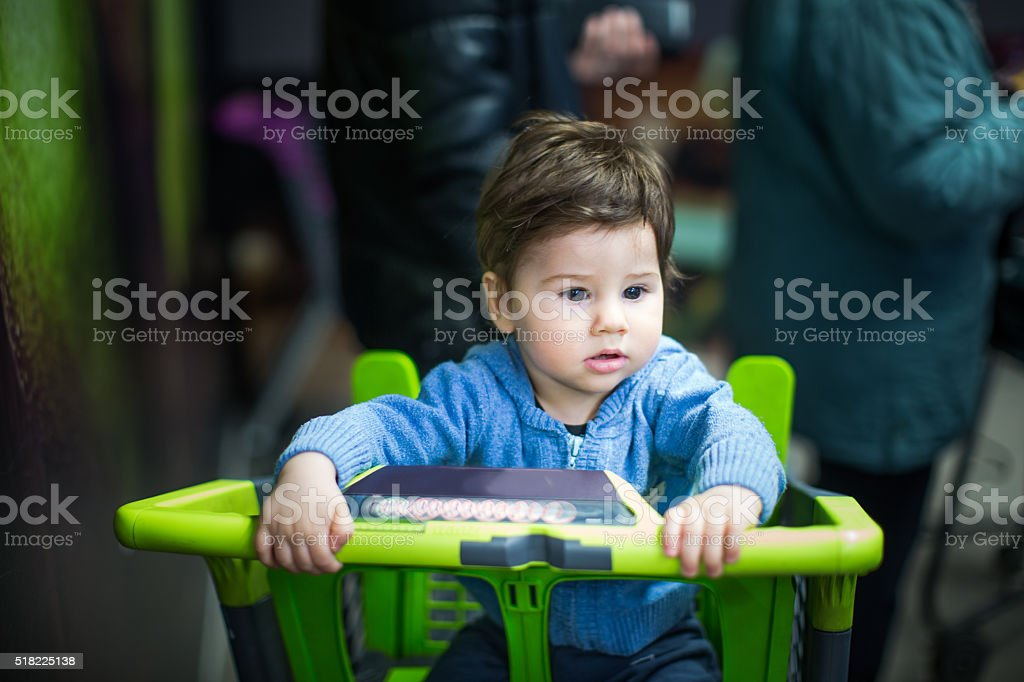 Cute little boy in chart in shopping mall stock photo