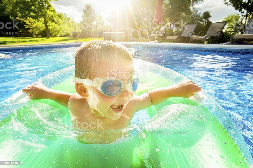 Cute Little Boy in Pool stock photo