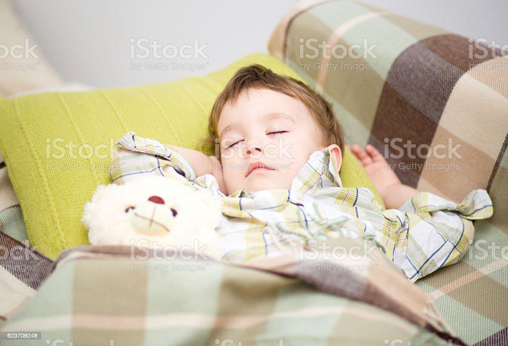 Cute little boy is sleeping stock photo