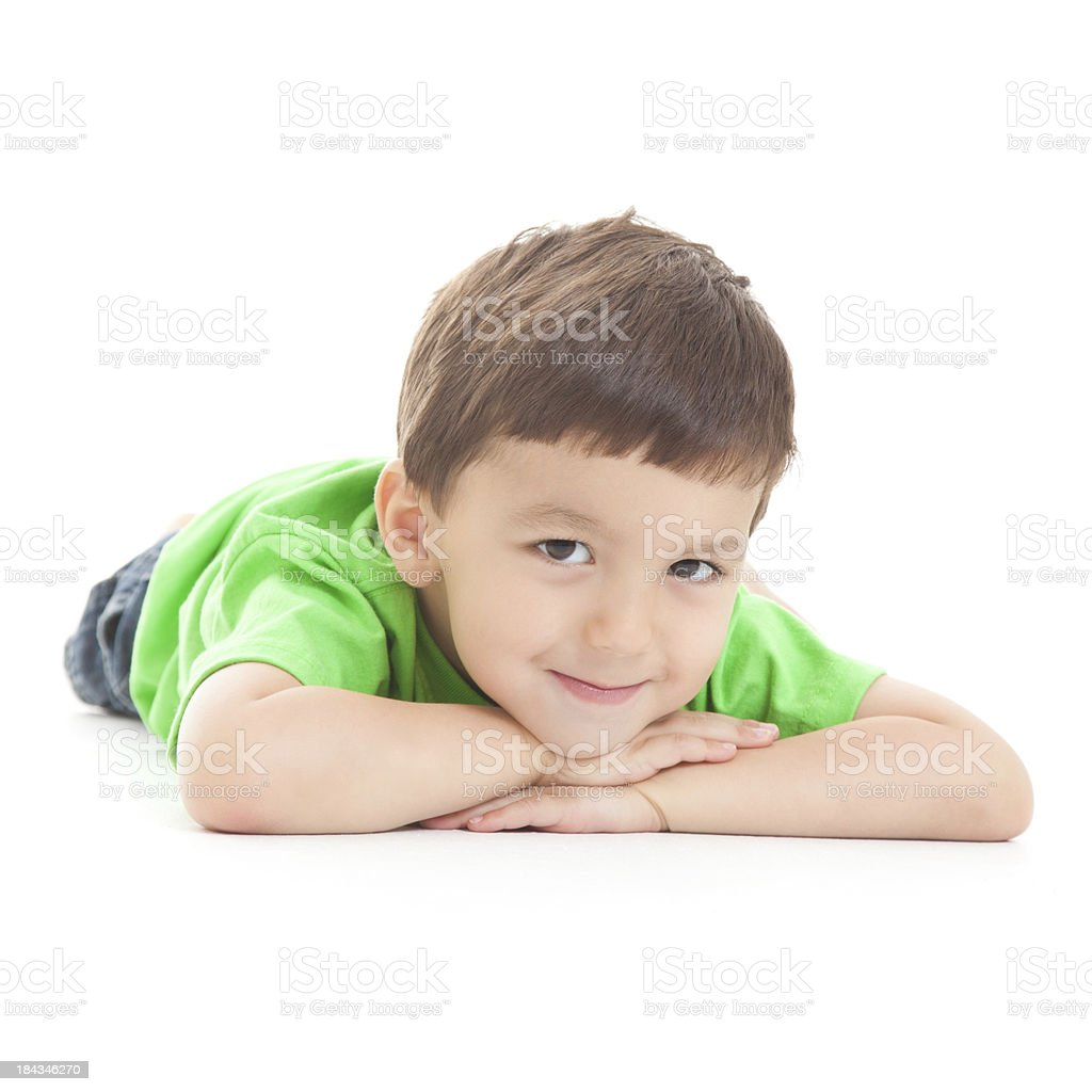 Cute Little Boy Laying Down Looking Forward, on white background royalty-free stock photo