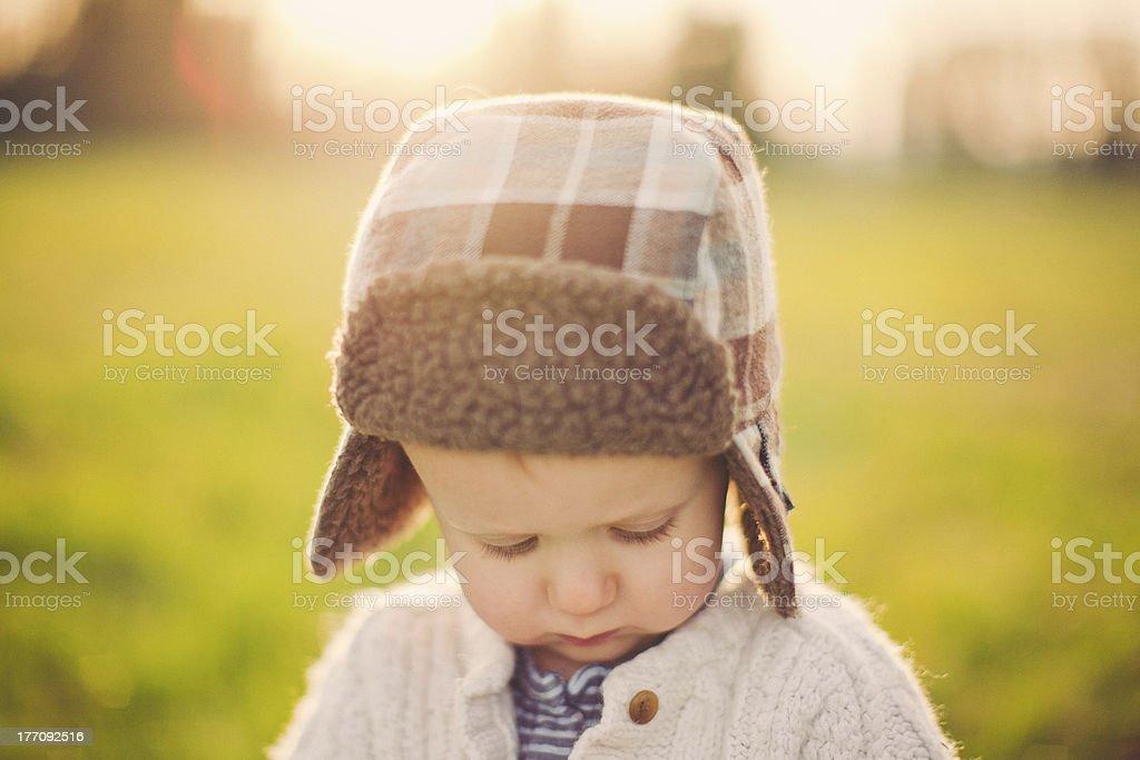 Cute Little Boy Looking Down stock photo