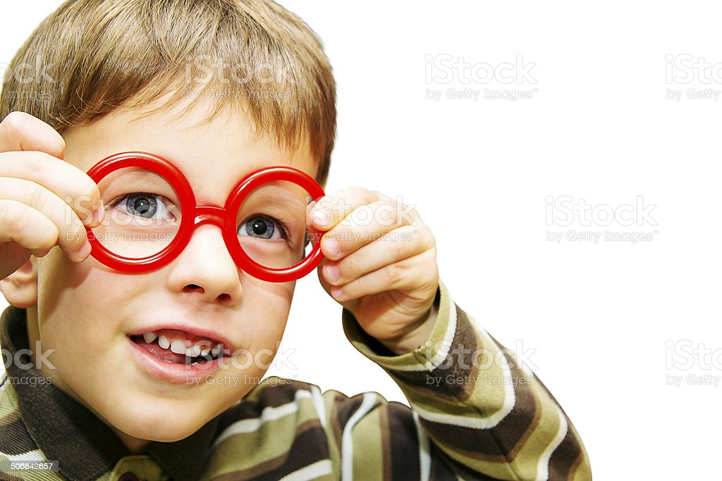 Cute little boy looking through toy red glasses royalty-free stock photo