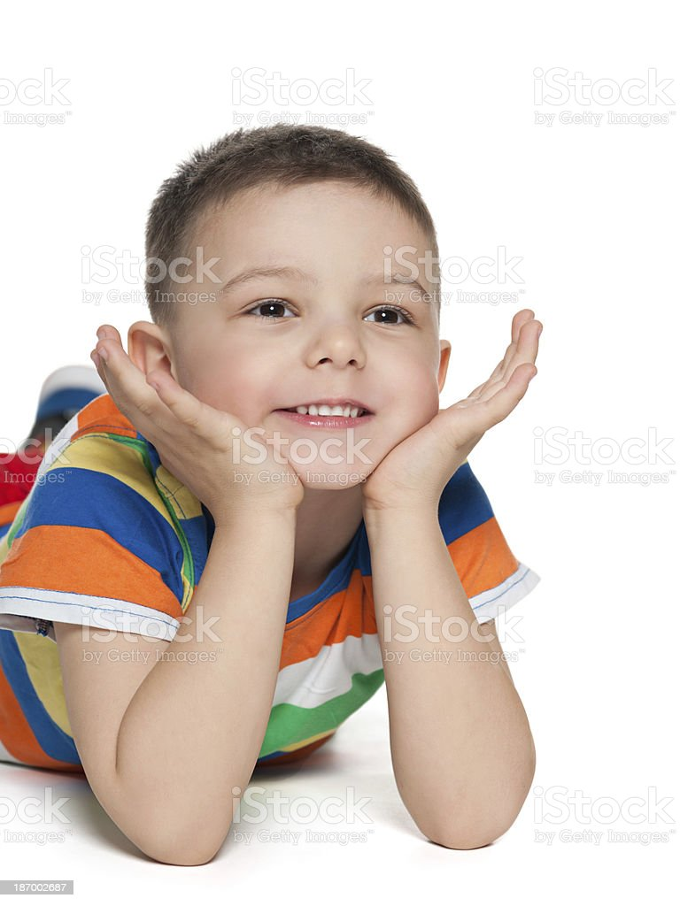 Cute little boy looks aside royalty-free stock photo
