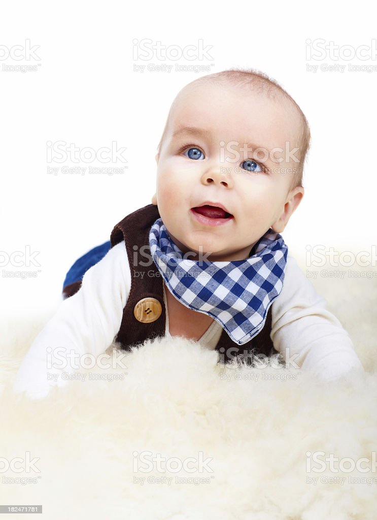 Cute little boy lying on fur stock photo