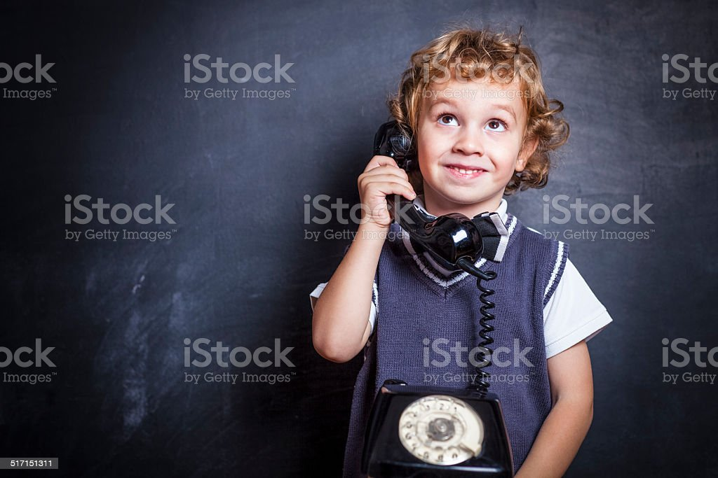 Cute little boy on the phone stock photo