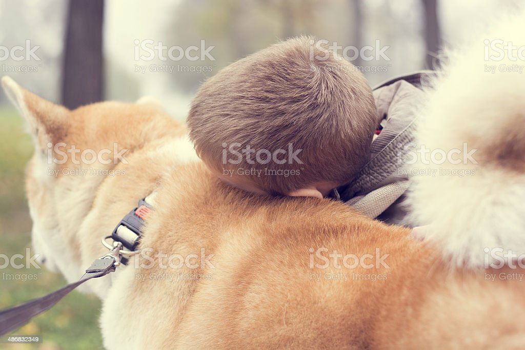 Cute little boy outdoors with dog royalty-free stock photo
