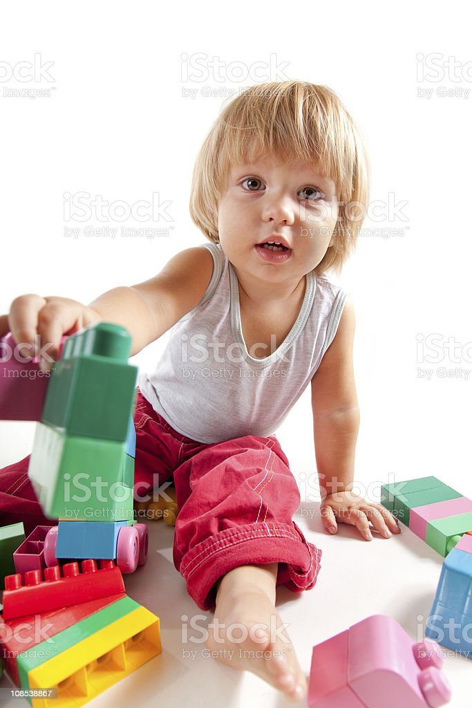 Cute little boy playing with blocks royalty-free stock photo
