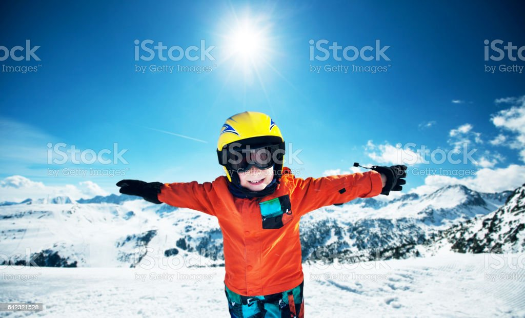 Cute little boy posing on camera in Andorra ski resort stock photo