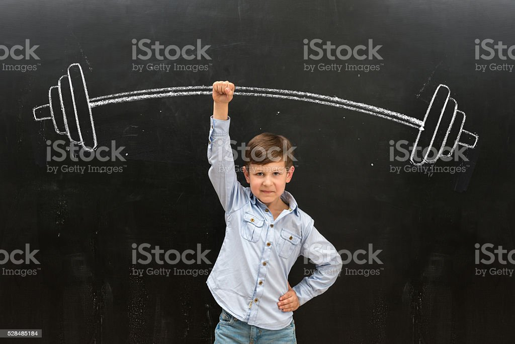 cute little boy rising drawn barbell on finger stock photo