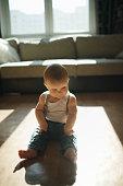 cute little boy sitting on the floor