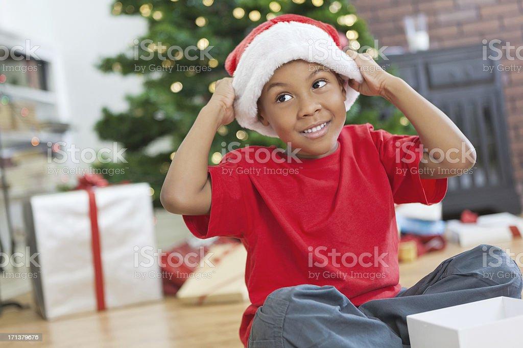 Cute little boy wearing Santa hat on Christmas morning royalty-free stock photo