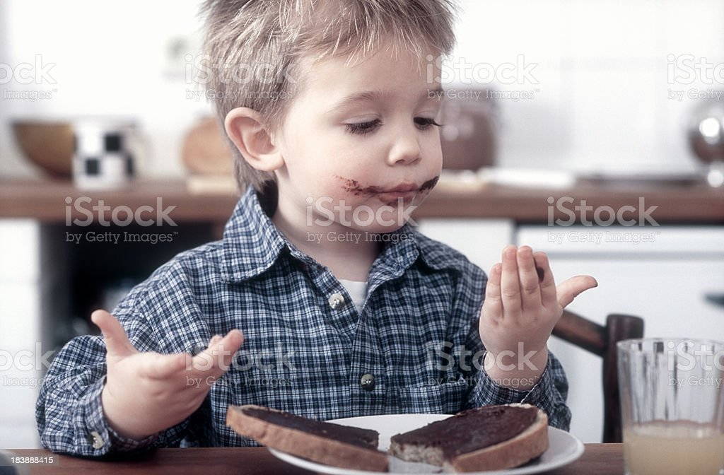 Cute little boy with chocolate sandwich royalty-free stock photo