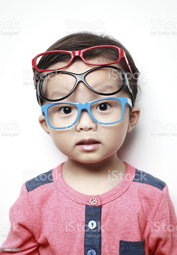 Cute little boy with glasses royalty-free stock photo