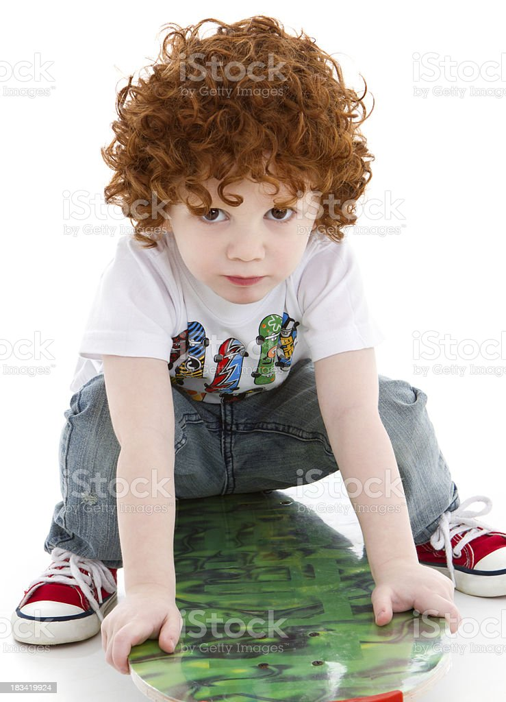 Cute little boy with skateboard royalty-free stock photo