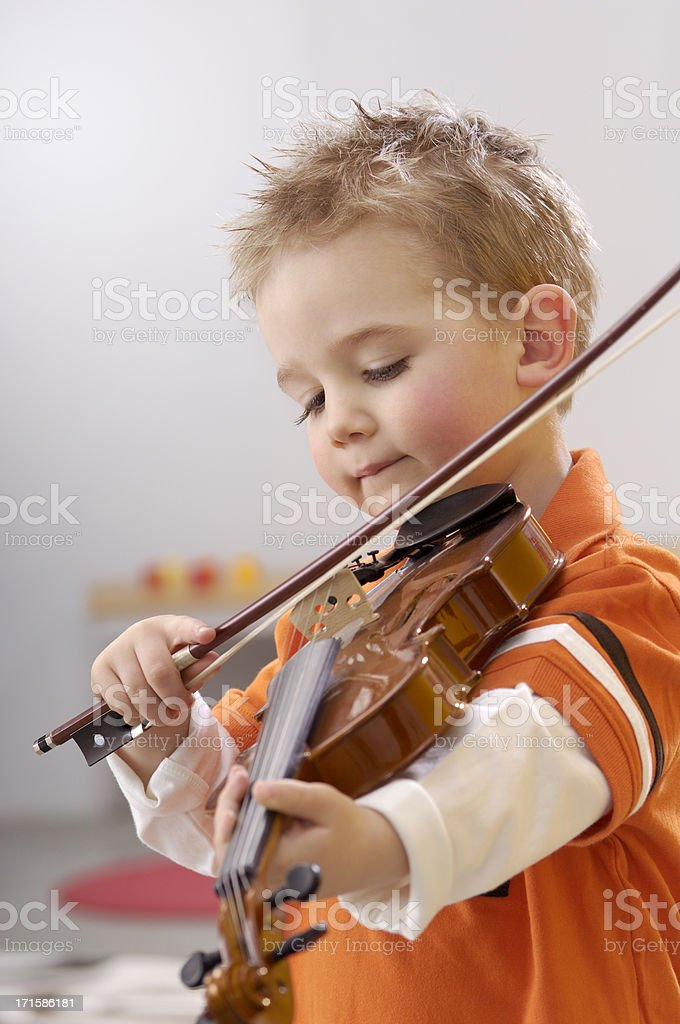 Cute little boy with violin royalty-free stock photo