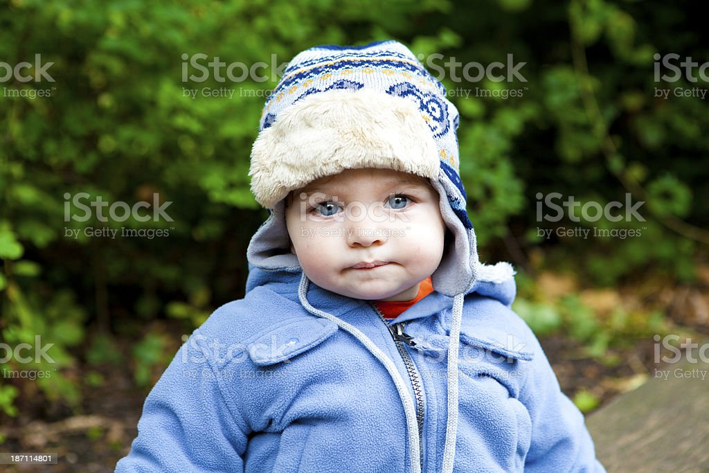 Cute little boy with warm winters hat stock photo