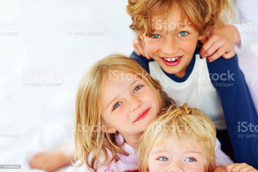Cute little brothers and sisters playing together royalty-free stock photo
