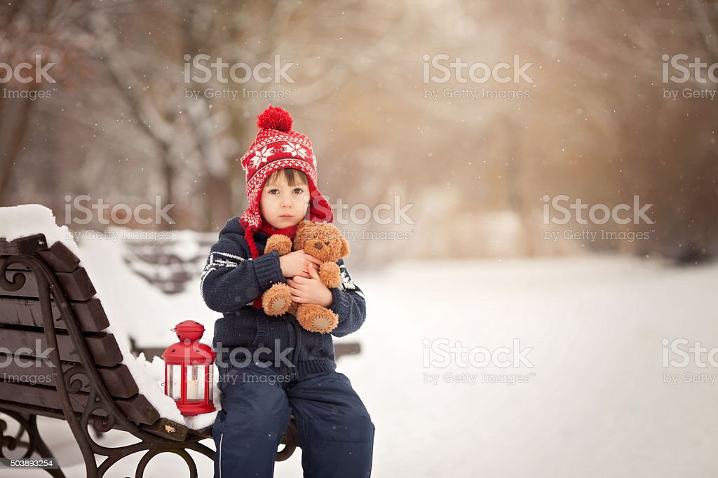 Cute little caucasian boy with teddy bear and red lantern stock photo