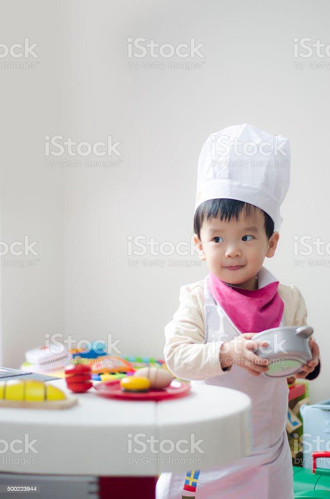 Cute little chef stock photo