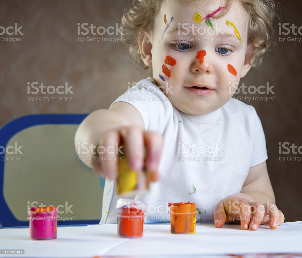Cute little child painting royalty-free stock photo