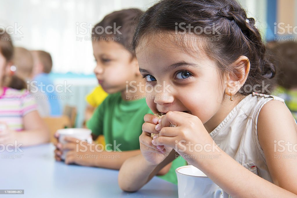 Cute little children drinking milk stock photo