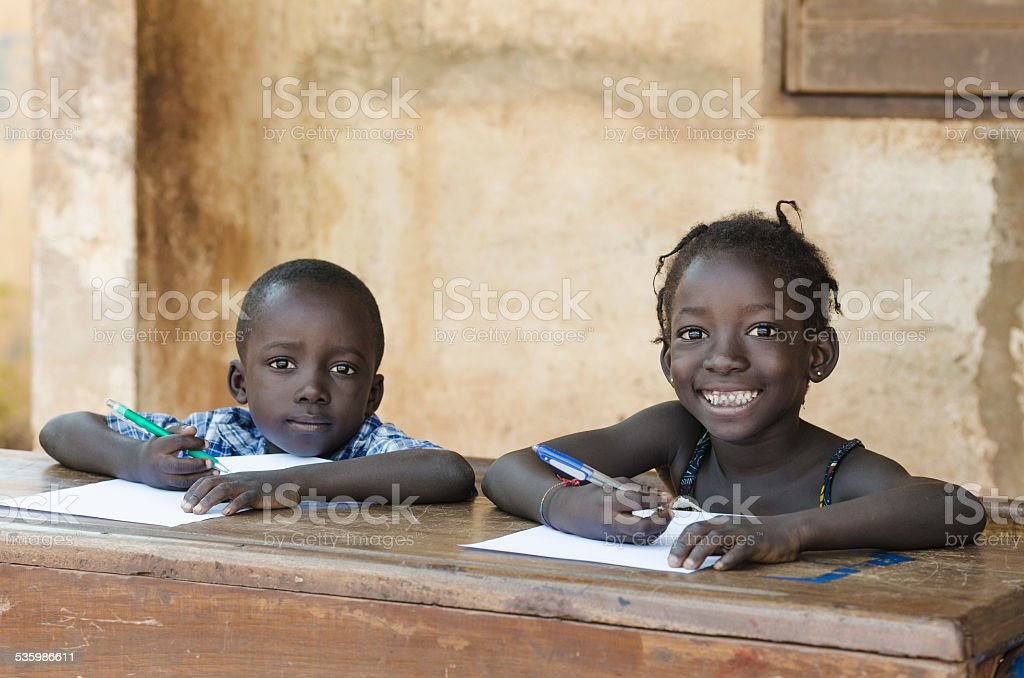 Cute Little Children Learning with Pens Paper in Mali, Africa stock photo