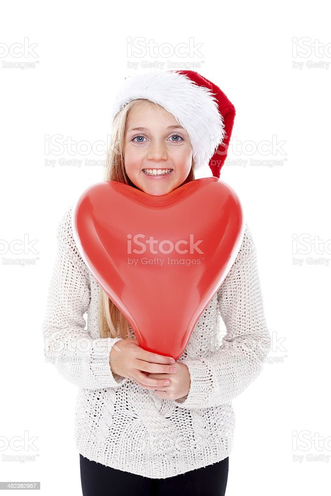 Cute little Christmas girl with balloon royalty-free stock photo