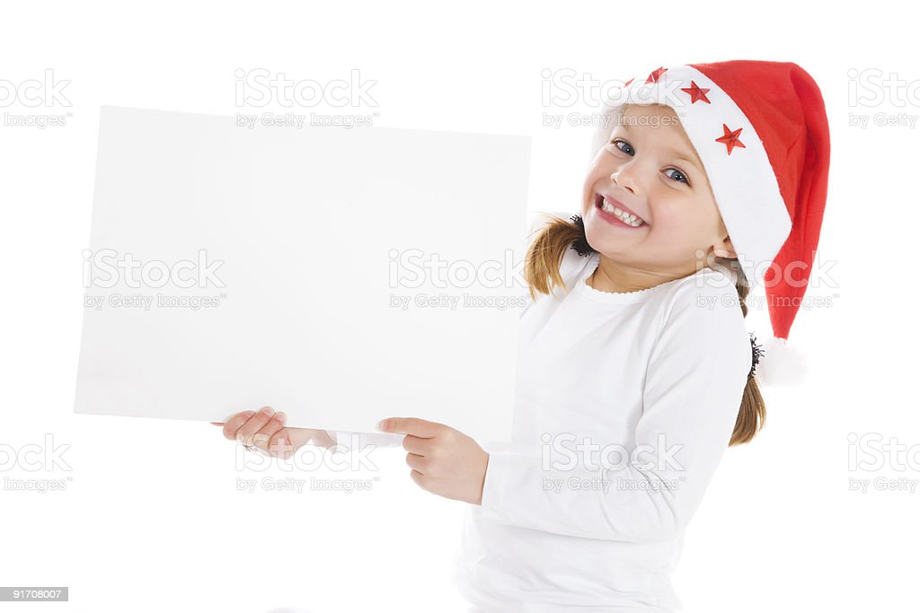 cute little christmas girl with blank sign royalty-free stock photo