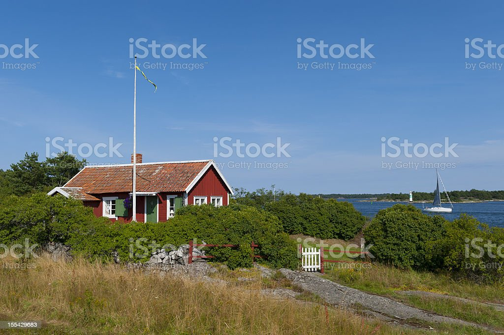 Cute little cottage in the archipelago royalty-free stock photo