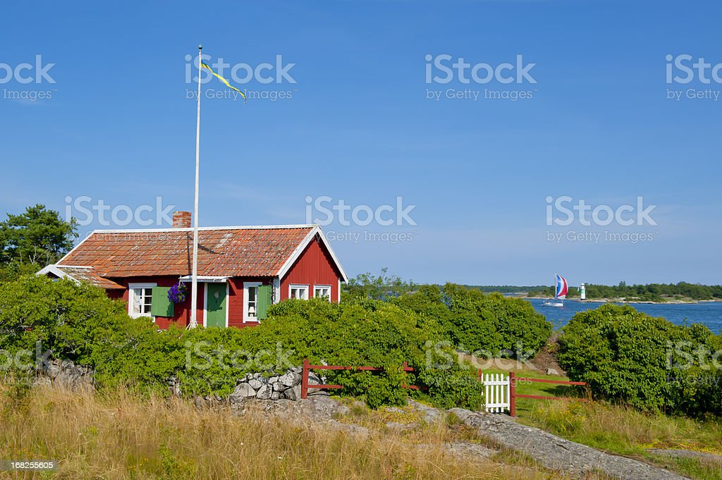 Cute little cottage in the archipelago stock photo
