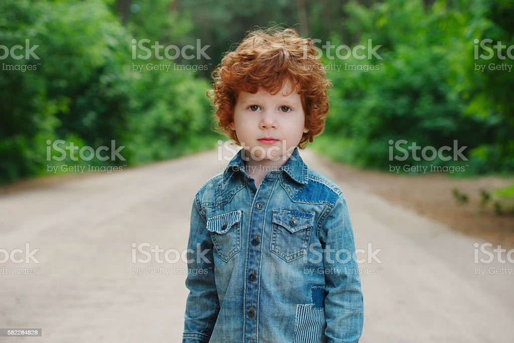 cute little emotional boy outdoors stock photo