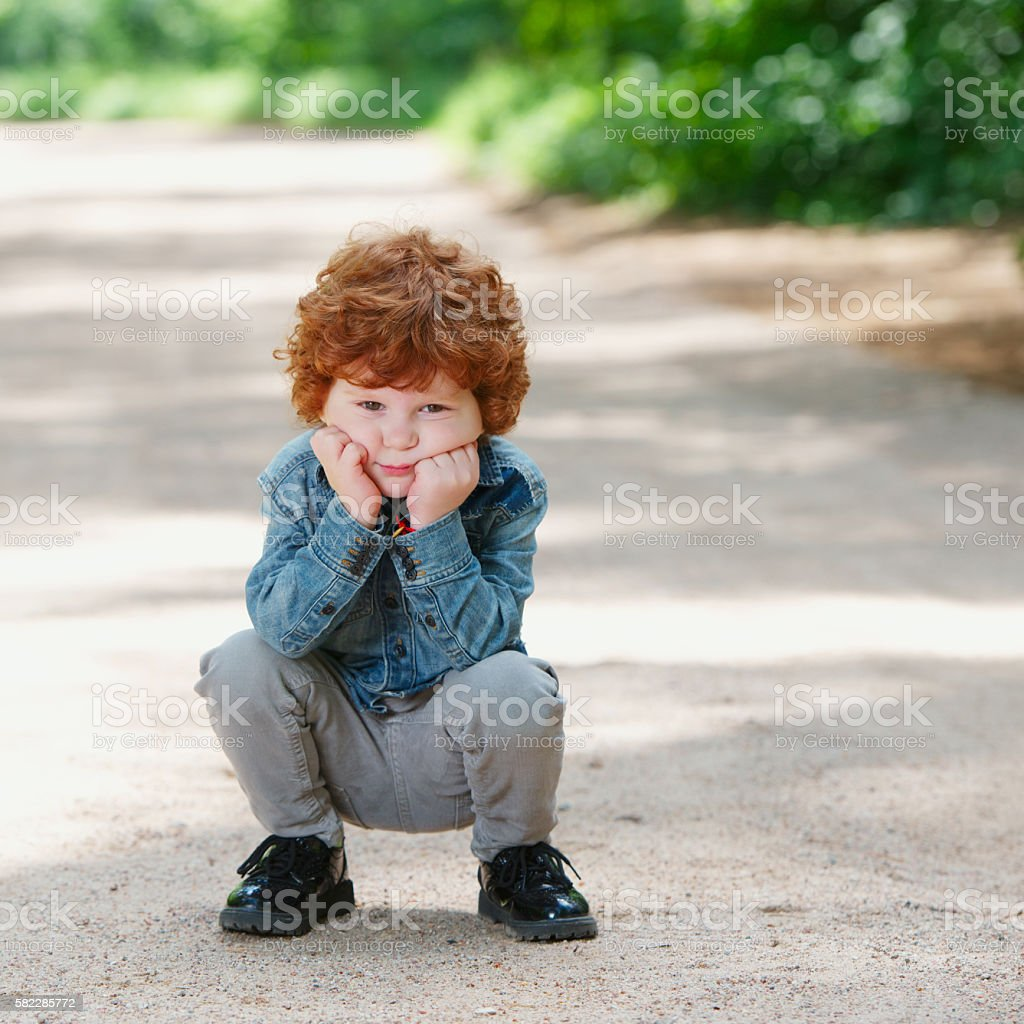 cute little emotional boy outdoors stock photo