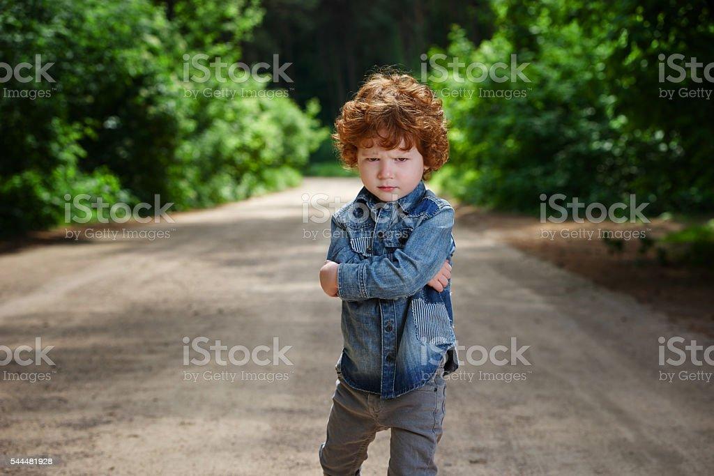 cute little emotional boy stock photo