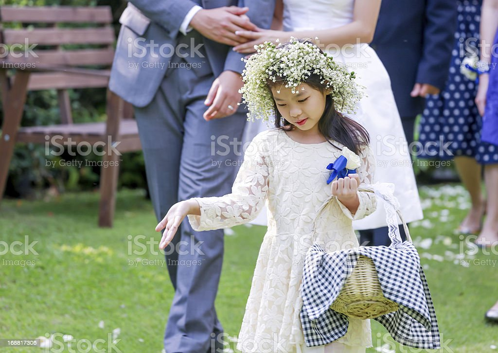 Cute little flower girl in the wedding ceremony royalty-free stock photo
