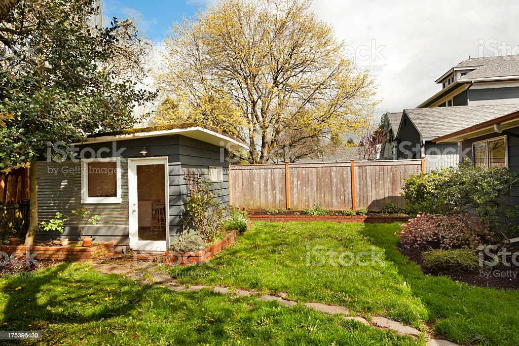 Cute little garden shed in back yard stock photo