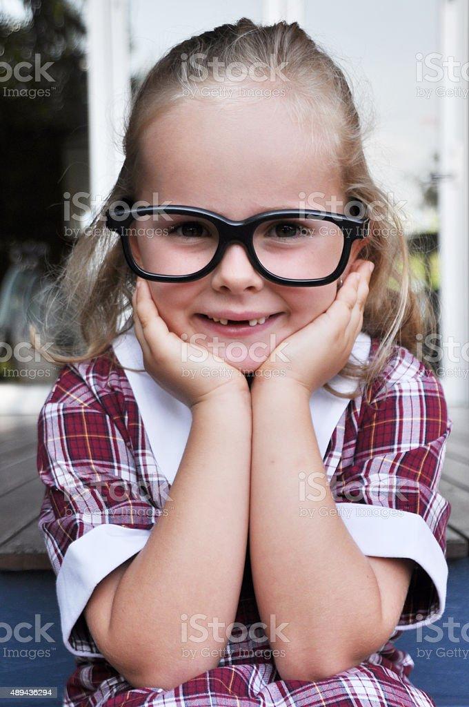 Cute little geeky girl stock photo