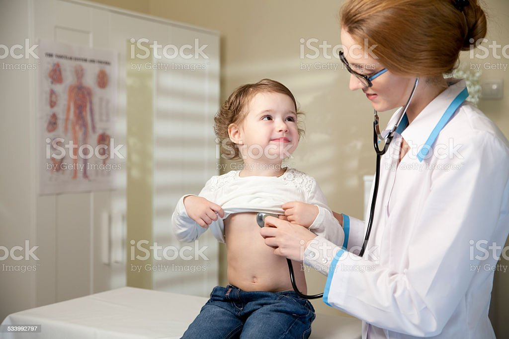 Cute little girl and doctor stock photo