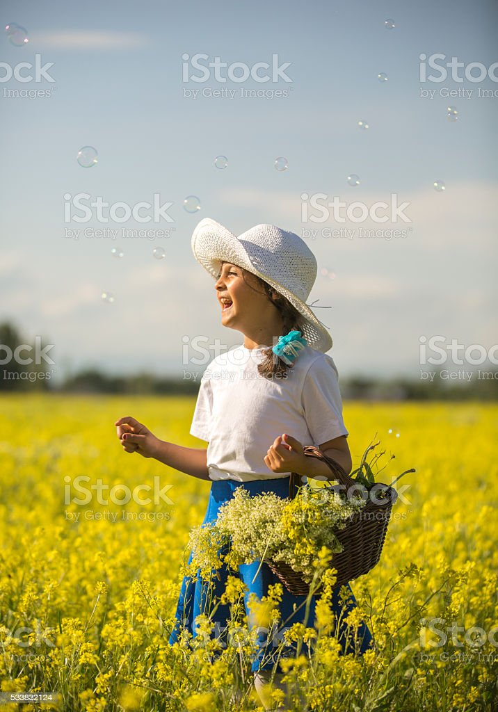 Cute little girl and flowers stock photo