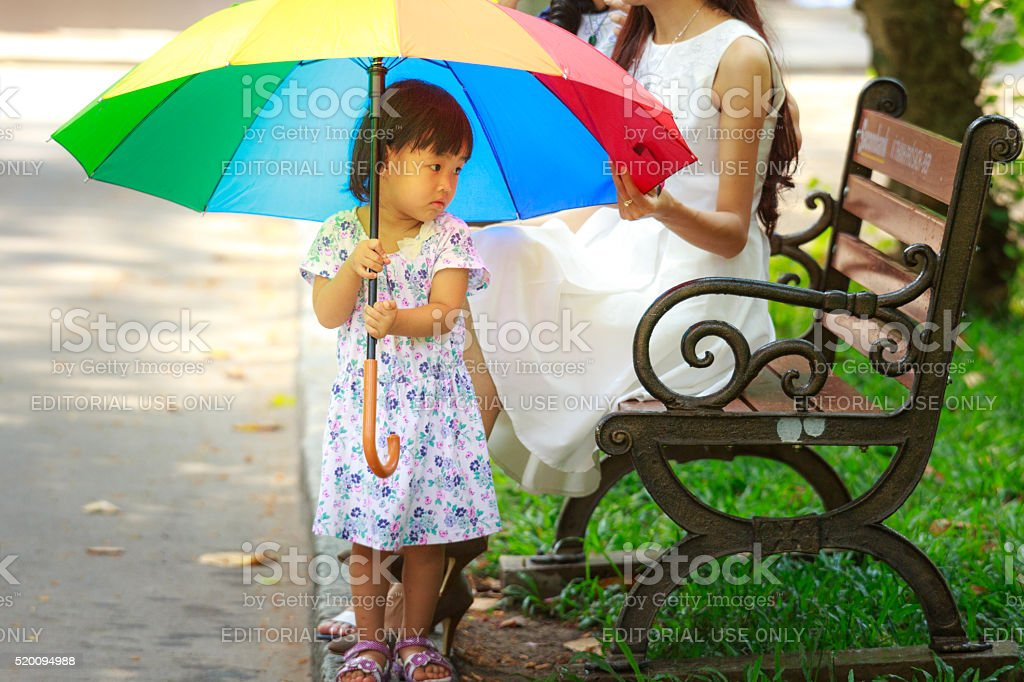 cute little girl and umbrella have rainbow colors stock photo