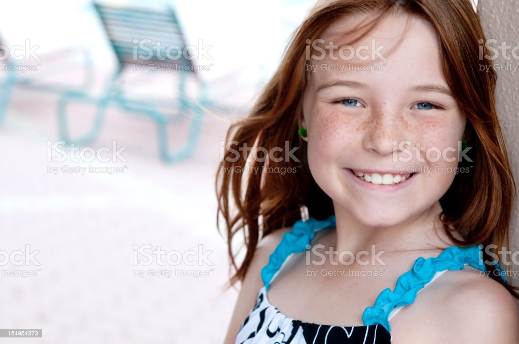 Cute Little Girl at the Swimming Pool royalty-free stock photo