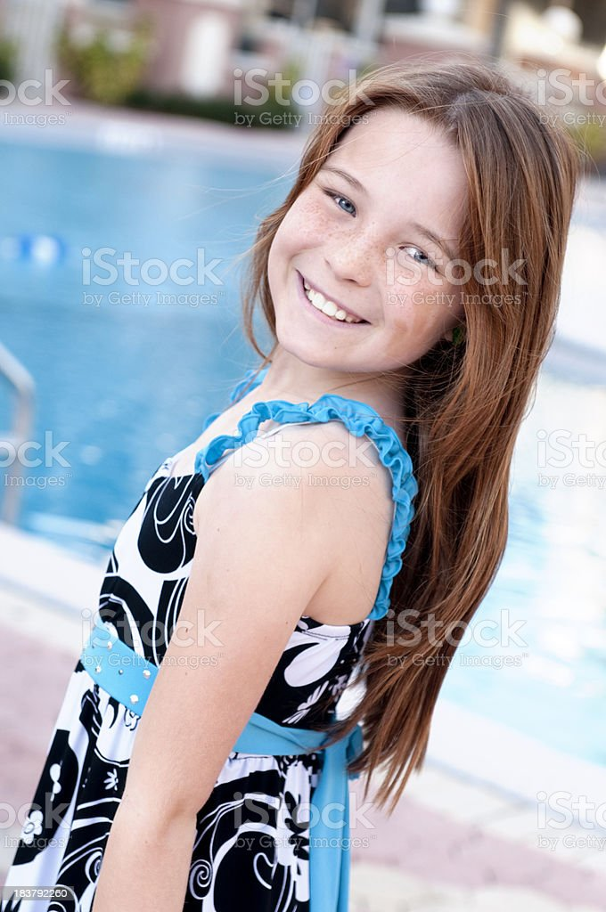 Cute Little Girl at the Swimming Pool stock photo