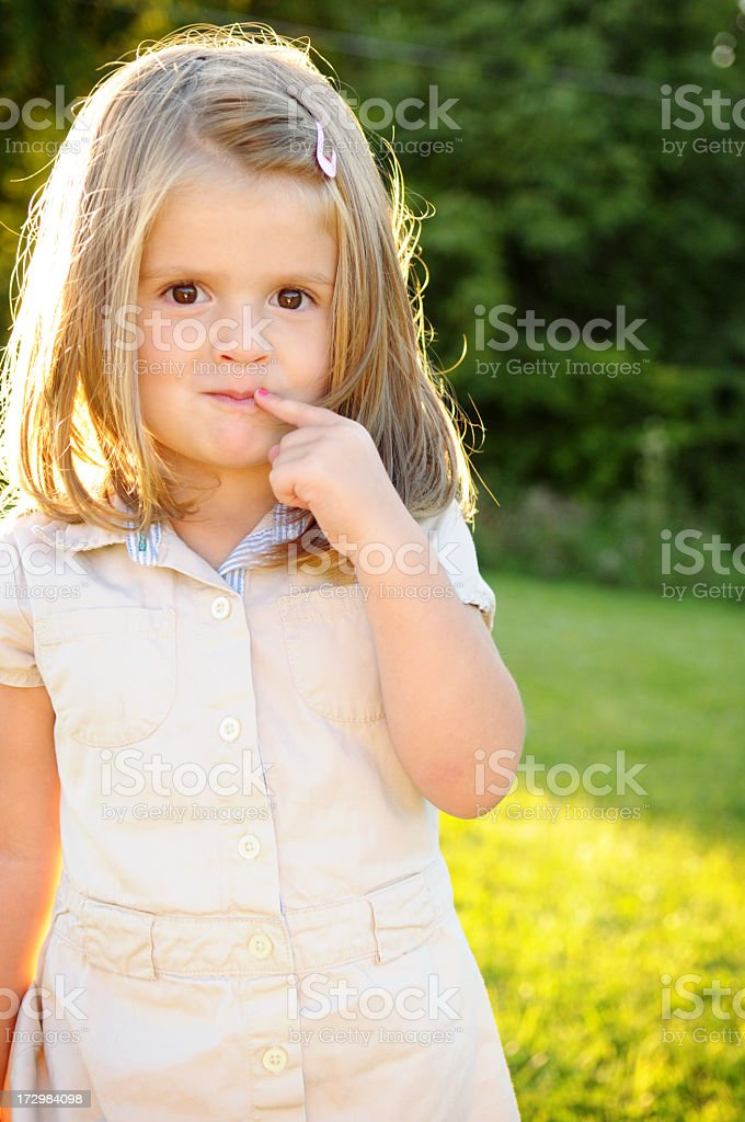 Cute Little Girl Backlit by the Evening Sun royalty-free stock photo