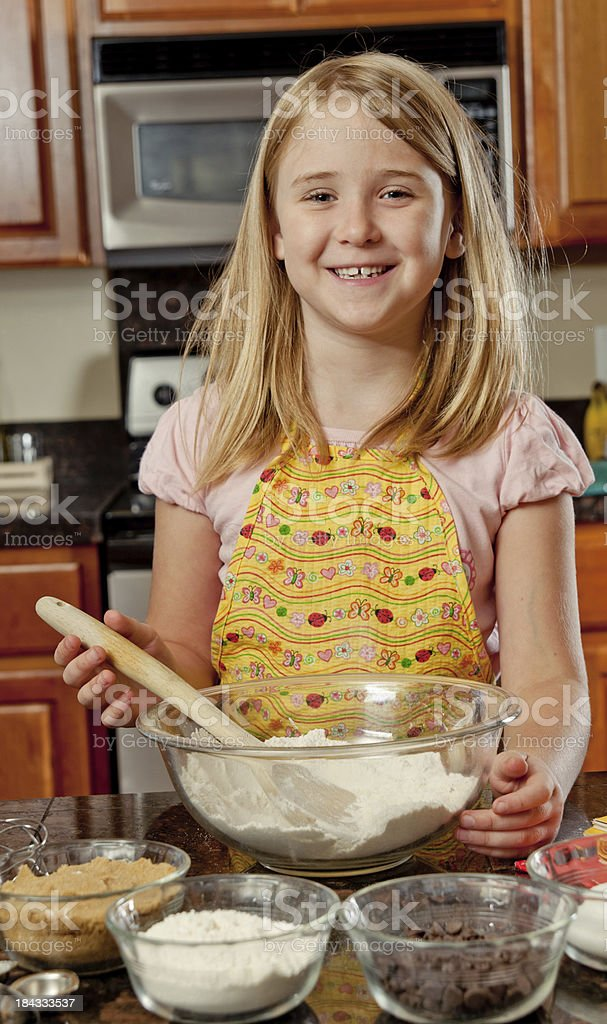 Cute little girl baking in the kitchen royalty-free stock photo