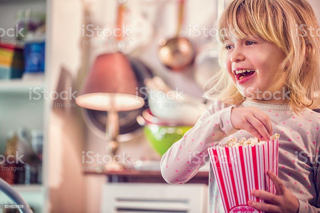 Cute Little Girl Eating Homemade Popcorn stock photo