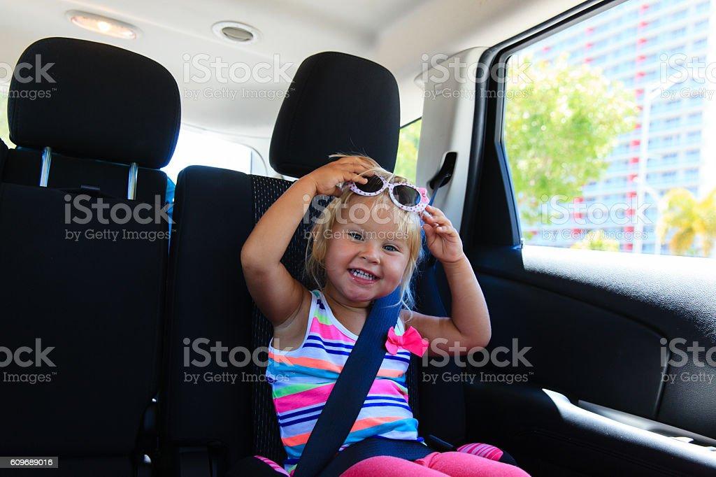 cute little girl enjoy travel by car stock photo